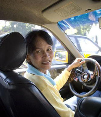 Thai woman working as a taxi driver . Thailand , January 18 , 2007 .